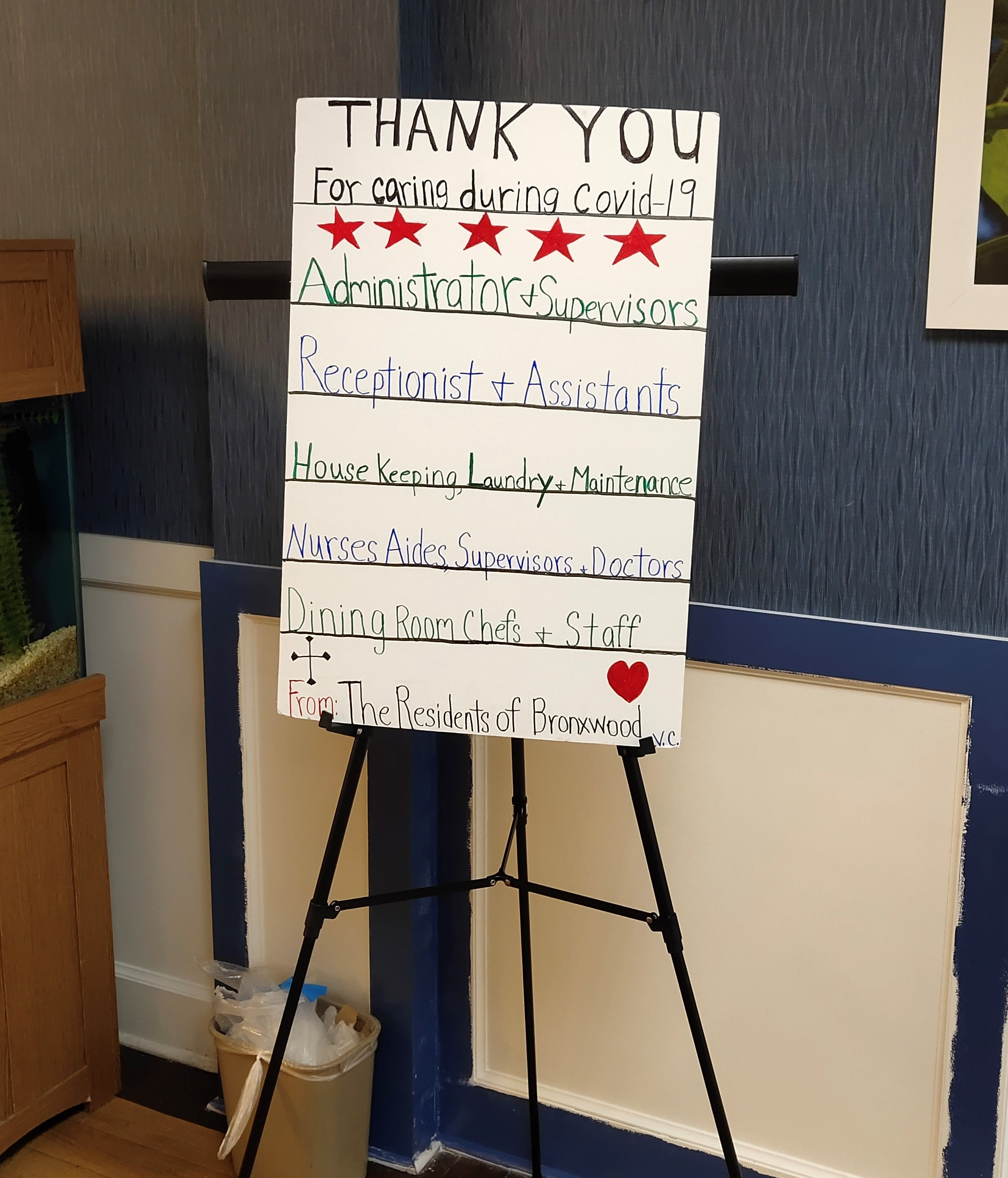 Image of a poster on a stand thanking the staff of an adult care facility for their dedication and hard work